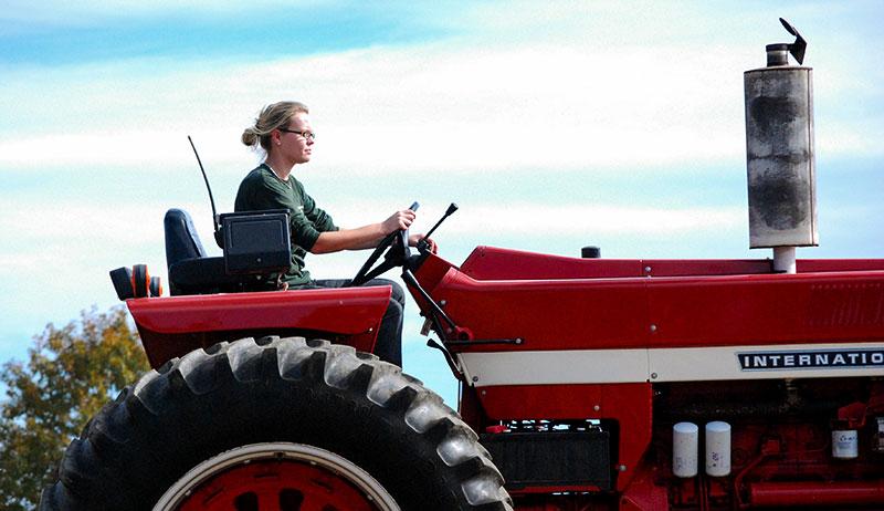 farm equipment woman tractor