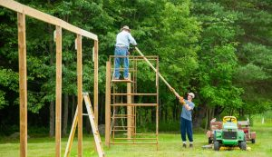 Building an orchard fence using scaffolding