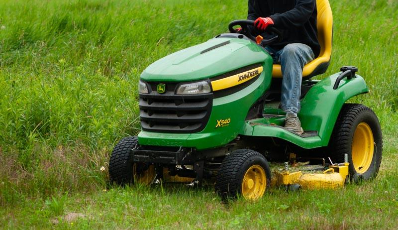 mow overgrown field grass