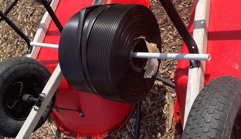 unroll unrolling drip irrigation line