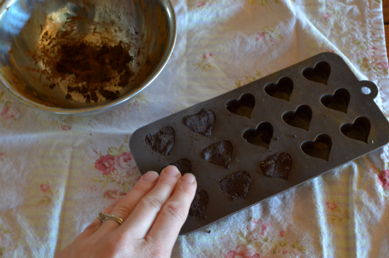 pack silicone candy mold with herb/honey mixture