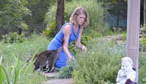 woman farmer cutting herbs