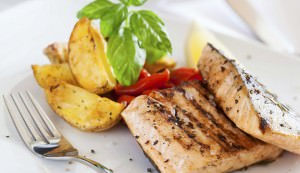 Grilled salmon filet with baked potatoes