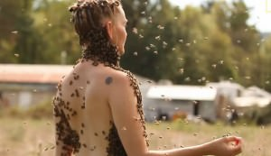 woman dances with bees