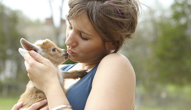 Youth Woman And Baby Goat