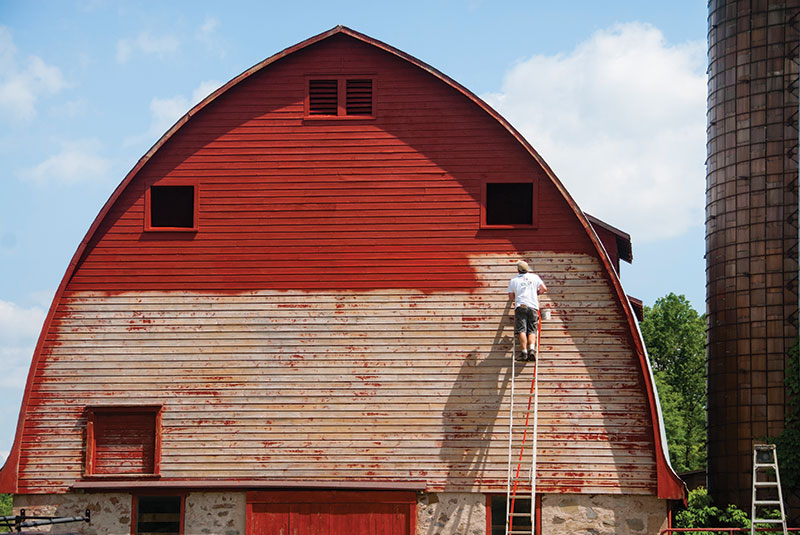apply paint to barn