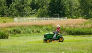 riding lawn mower mowing