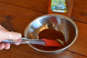 mix honey into ground herb
