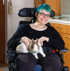 therapy animals rabbit woman wheelchair